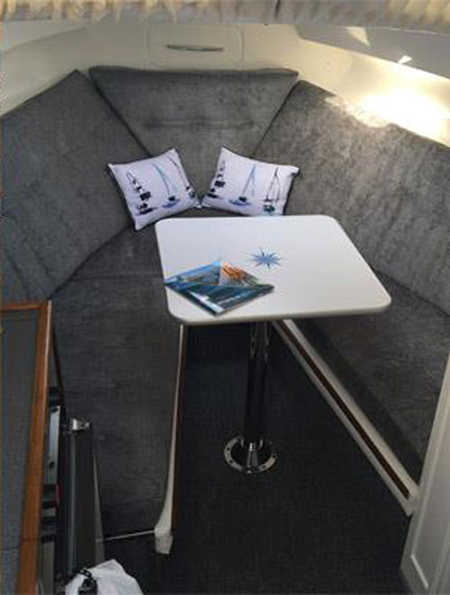 A re-upholstered yacht V berth seating and sleeping area