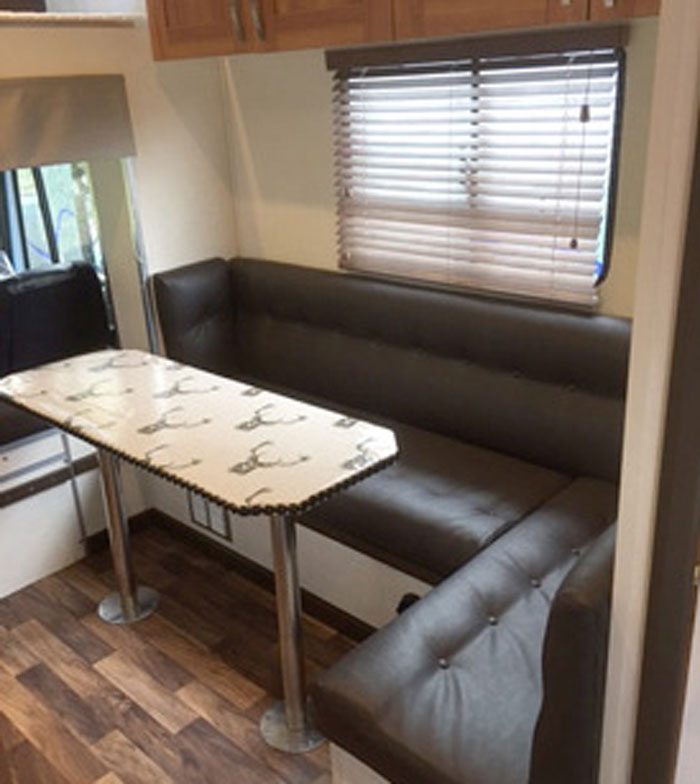 The same horsebox setaing area re-upholstered in a practical wipe-clean vinyl fabric