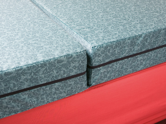 An example fo a foam 'split' mattress that can be folded and stored or used as a foam seat cushion.