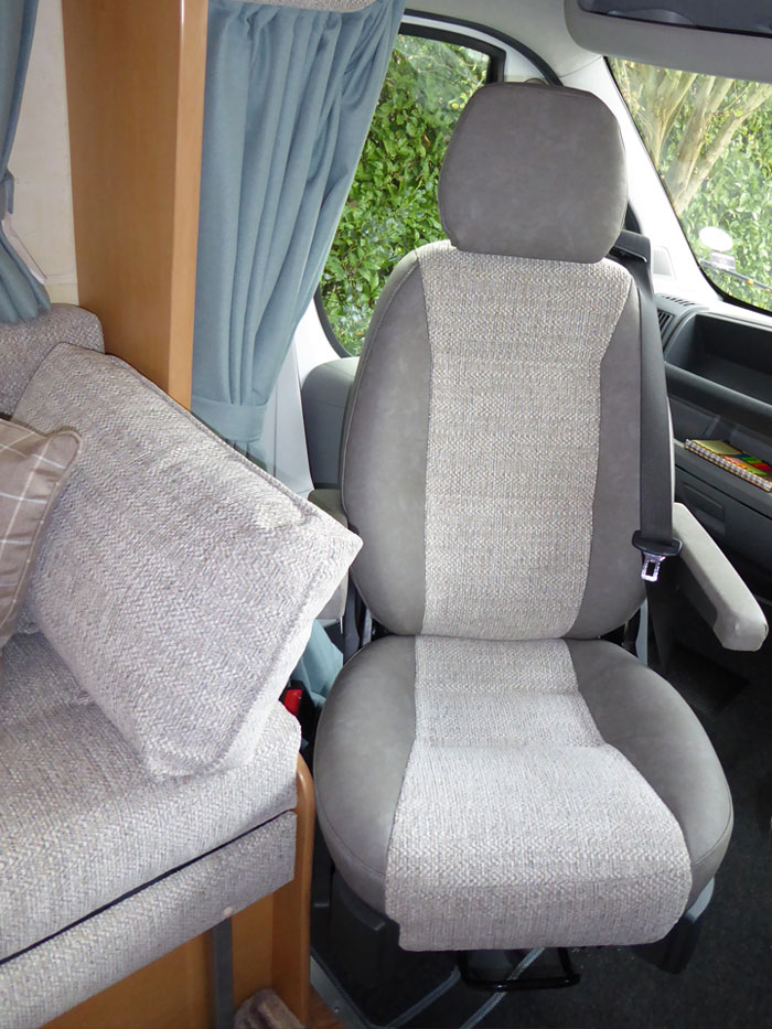 A motor home cab-seat and interior re-upholstered in matching fabrics