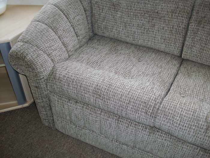 Free standing sofa re-upholstered in a mordern and hard wearing chenille fabric