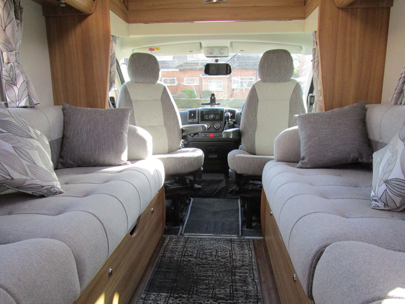 A trnsformed motorhome interior with new seat cushions and upholstery
